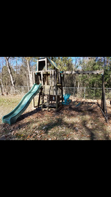 Heavy Wooden swing set with club house and slide in Spring, Texas