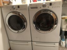 LG front loader washer and gas dryer with pedestals in Chicago, Illinois