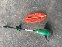 Weed eater and extension cord in Okinawa, Japan