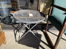Folding metal side table in St. Charles, Illinois
