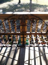 Iron bench and matching plant stands in Livingston, Texas