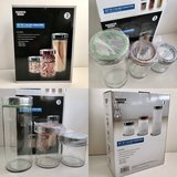NIB Sharper Image glass canister set in Glendale Heights, Illinois