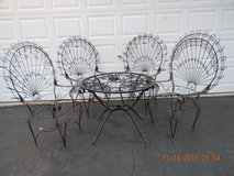 5 PIECE WROUGHT IRON TABLE AND CHAIRS. in Plainfield, Illinois
