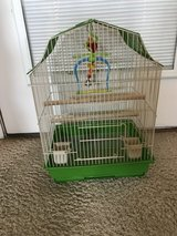 Birdcage with accessories in Warner Robins, Georgia