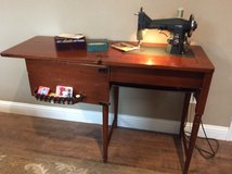 Kenmore sewing machine with wood cabinet in Conroe, Texas