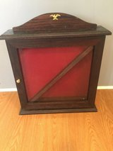Solid dark oak flag /medals display case in Fort Campbell, Kentucky