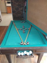 Bumper pool table/dinngroom table very heavy including pool stick and balls. in Fort Campbell, Kentucky