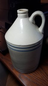 Stoneware jug with blue and white stripes in Bolingbrook, Illinois