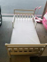 White toddler bed and mattress in Camp Pendleton, California