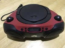 Red/black CD/AM/FM/auxiliary player in Conroe, Texas