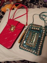 Two small cross body phone holder /purse in Fort Bragg, North Carolina