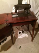 Kenmore sewing machine in cabinet in Bolingbrook, Illinois