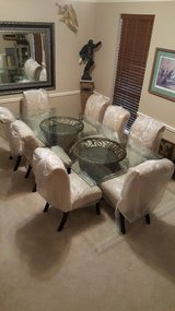 Solid beveled  glass large dining table with eight chairs in Kingwood, Texas