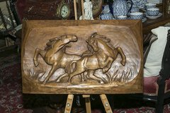Hand carving relief plying  horses in Ramstein, Germany