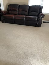 Leather couch with reclining ends in Camp Lejeune, North Carolina
