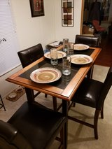 Authentic Granite and Wood Table and Leather Chairs in Fort Leonard Wood, Missouri