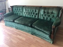 Beautiful emerald vintage couch in Yucca Valley, California