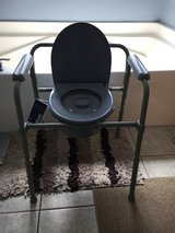 Bed side/over toilet commode chair in Byron, Georgia