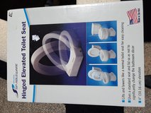 Toilet riser seat  new in Yucca Valley, California