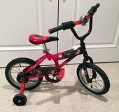 """Huffy 14"""" boys bike with training wheels in Chicago, Illinois"""