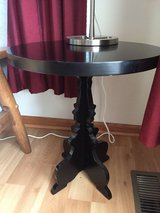 Black round end table in Glendale Heights, Illinois
