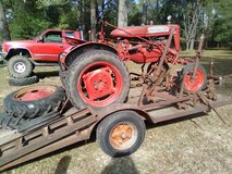 FARMALL TRACTOR with trailer in Leesville, Louisiana