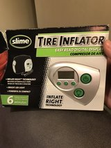 Tire inflator by slime in Oswego, Illinois