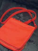 Fossil electric orange all leather cross body handbag with gold hardware in The Woodlands, Texas