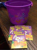 Easter bucket & 4 game tablets in Aurora, Illinois