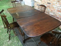 Exotic Antique Walnut Black and Brown Dinner Table With Center Leaf and Hardwood Chairs in Camp Lejeune, North Carolina