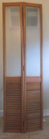 "2 sets Folding Wooden Louvered Closet Doors.  6'8"" tall. in Conroe, Texas"