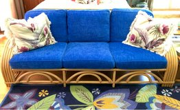 Vintage newly reupholstered Ficks Reed five band arm rattan couch in Naperville, Illinois