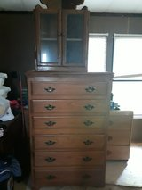 a dresser and a walnot Shelf in Kingwood, Texas