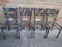 Metal graffiti chairs in The Woodlands, Texas