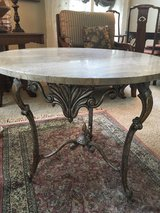 Marble table and iron base in Bolingbrook, Illinois