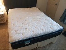Queen bed with a head and box in Fairfax, Virginia