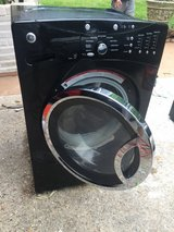 Black lg front loading washer and dryer in Cleveland, Texas