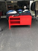 Bright red locker style TV cabinet in Joliet, Illinois