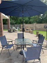Patio Table & 4 chairs, also have an umbrella in Baytown, Texas