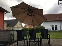 5 Blue Plastic Adirondack style patio chairs in Ramstein, Germany