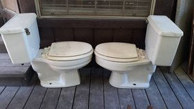 2 toilets beige color in Houston, Texas