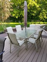 outside table and 6 chairs . Umbrella like new in Palatine, Illinois