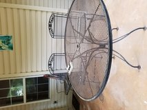 Black wrought iron patio set. 48 inch round table with 2 spring back chairs and 2 rocking chairs... in Macon, Georgia