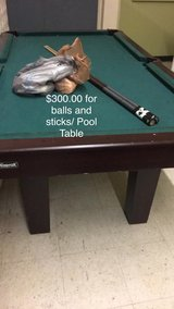 Pool Table with Sticks and Balls in Fort Leonard Wood, Missouri