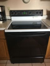 "GE ""True Temp"" electric self-cleaning range and oven in DeKalb, Illinois"