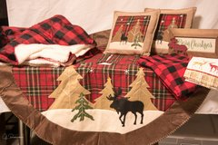 NORTH WOODS--Christmas tree skirt, two throws, two pillows, table cloth and two kitchen towels in Conroe, Texas