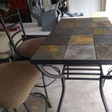 Stone top Table with 4 - swivel bar stools. in Fort Knox, Kentucky