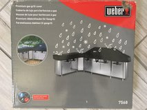 Weber grill cover never used in Aurora, Illinois