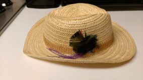 Straw hat with feather in Warner Robins, Georgia
