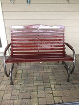 WOODEN AND CAST ALUMINUM GLIDER BENCH in Westmont, Illinois